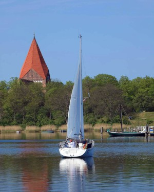 Sailboat on the Kirchsee with the church in the background
