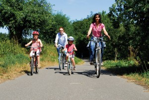 A family cycles through Werden district of Essen in the Ruhr
