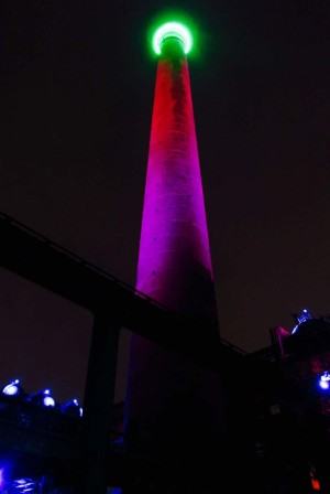 European Route of Industrial Heritage - A chimney in the Landscape Park glows in the dark