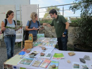 Geopark ranger helping walkers to plan their route using geopark walking maps