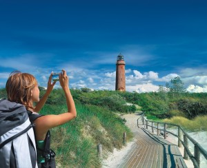 Darss, woman with camera outside lighthouse