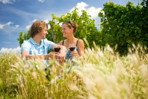 Norheim, couple enjoying wine in the vineyard