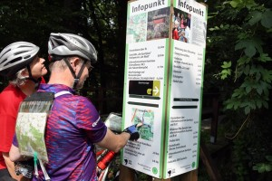 Biosphere reserve near Oranienbaum, looking for the next great destination: cyclists at the information board