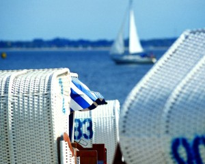 Schleswig-Holstein, beach and sailing boat at the baltic coast