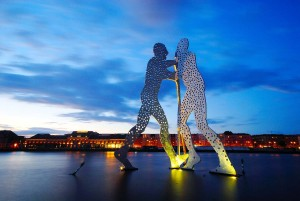Berlin/Spree: ''Molecule Man'' sculpture by Jonathan Borofsky in the river Spree in Friedrichshain, at dusk