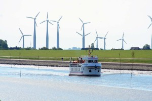 Near Husum: Boat on the water with wind turbines in the background